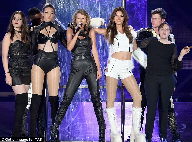 Leggy in leather: Dressed in a dominatrix style jumpsuit, the 25-year-old beauty oozed heaps of sex appeal as she pranced around the stage with her pals