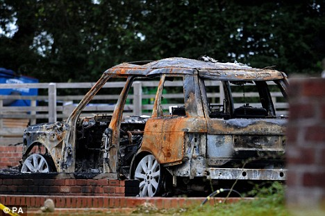 A burnt out Range Rover was just one of the vehicles destroyed in the inferno