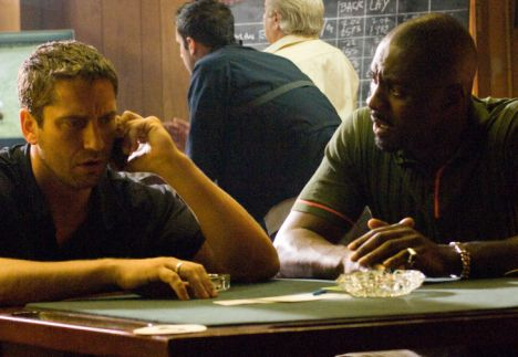 Gerard Butler as One Two and Idris Elba as Mubles in RocknRolla