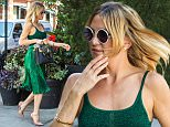Kate Hudson seen in a beautiful green dress in New York City, NY on July 10, 2015, as she goes to a restaurant after her appearance on the 'Today' show. \n\nPictured: Kate Hudson\nRef: SPL1071434  100715  \nPicture by: Splash News\n\nSplash News and Pictures\nLos Angeles: 310-821-2666\nNew York: 212-619-2666\nLondon: 870-934-2666\nphotodesk@splashnews.com\n