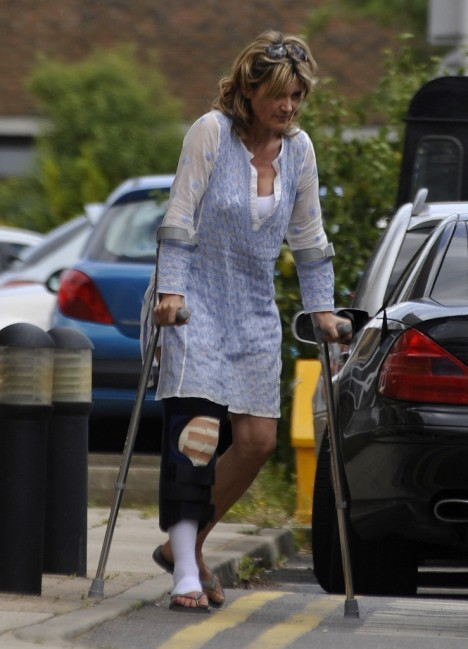Hobbling: Anthea struggles with her crutches