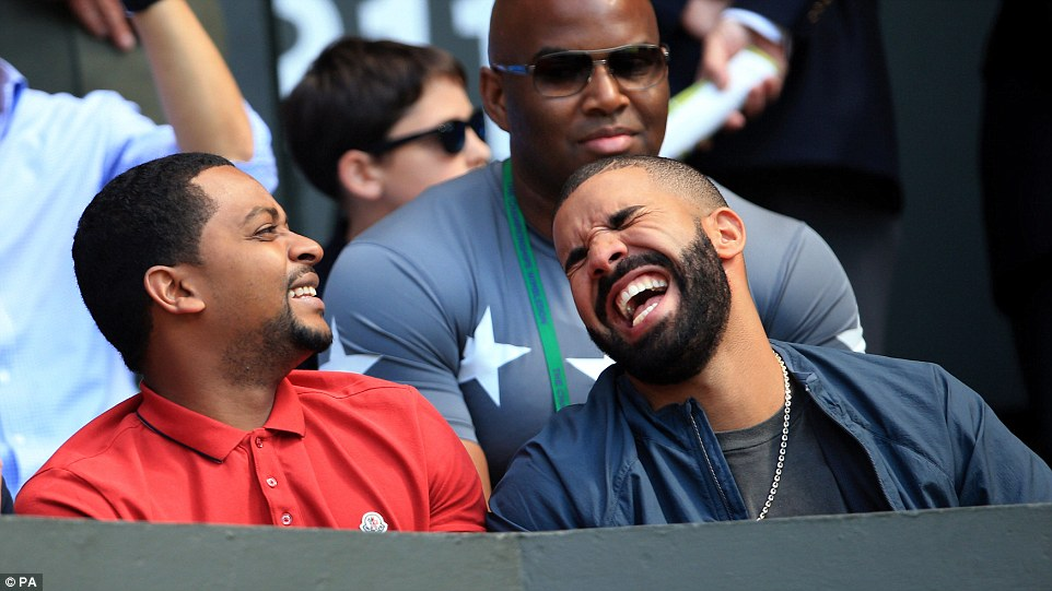 What a laugh: Drake was having a whale of a time on his second day in a row at WImbledon as he caught the Serena Williams and Maria Sharapova match
