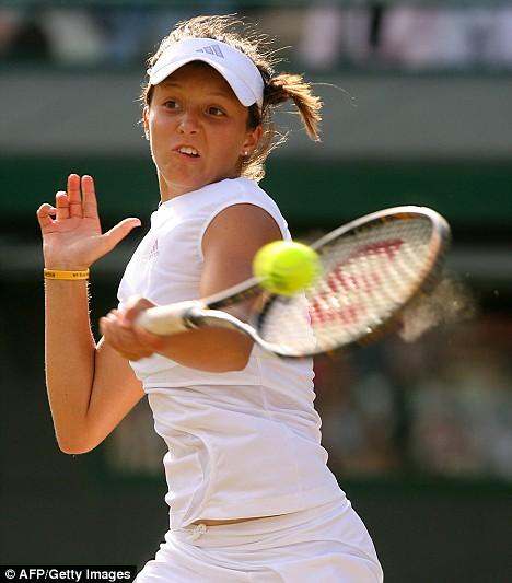 Returning volley: Laura returns the ball back to her Thai opponent Noppawan Lertcheewakarn