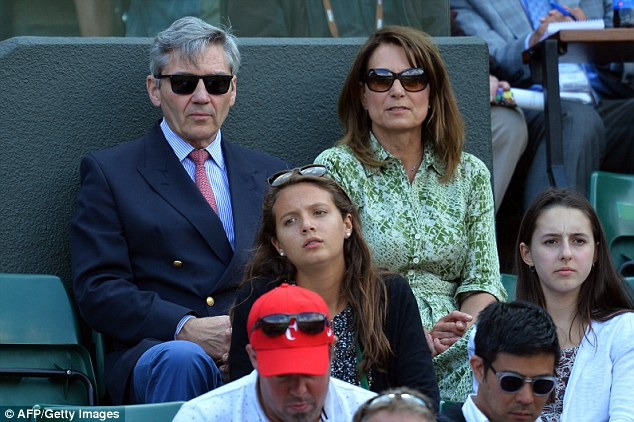 Carole and Michael Middletonenjoyed the balmy weather in the Royal Box on Wednesday for their second visit at Wimbledon this tournament