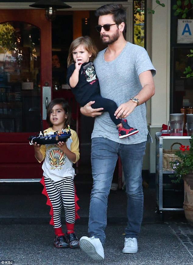 Rehab stint: Friends of Scott Disick have revealed he went into a facility for a matter of hours on Sunday in Florida; here he is pictured with Penelope and Mason in April in Calabasas