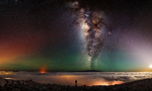 Ohio man Shane Black poses in front of active volcano, the moon and Milky Way