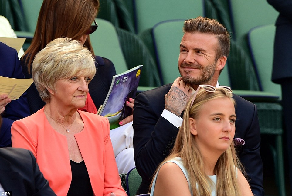 VIP seats: David flashed a big smile as her greeted other spectators and waited for the anticipated women's match to start