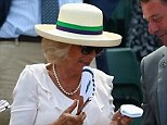 The Duchess of Cornwall (centre) will auction off a worn Andy Murray wristband for charity