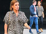 Wayne and Coleen Rooney celebrate the news that their 3rd child is on the way by going for a meal at Tattu Bar & Restaurant in Manchester city centre on Thursday night. Coleen was wearing a leopard print top, skin tight black jeans and high heel shoes while Wayne went more casual in jeans, trainers and a GOD FATHER t-shirt under his navy jacket....... 9.7.15.