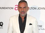 LOS ANGELES, CA - FEBRUARY 24:  Christian Audigier arrives at the 21st Annual Elton John AIDS Foundation's Oscar Viewing Party on February 24, 2013 in Los Angeles, California.  (Photo by Frederick M. Brown/Getty Images)