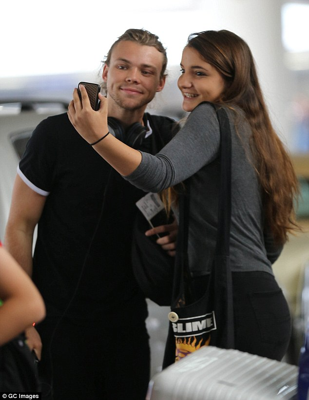 Airport selfies: A young fan stopped Ashton for a picture and he happily obliged at LAX