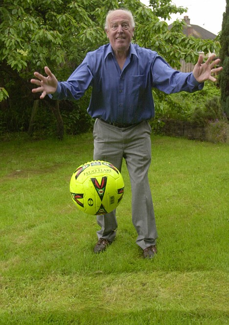 Preserved: Bob Gardam bounces a ball on the famous goal line turf which was laid in his former back garden. The house's new owner has decided to offer it up for sale