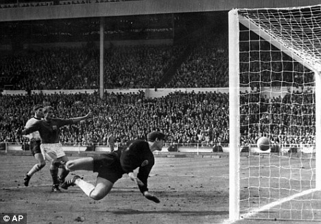 Historic bounce: The moment Geoff Hurst's shot hit the underside of the crossbar and cannoned straight back  down which the referee decided was a goal