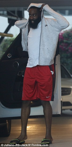 Bundling up: The Houston Rockets player was spotted in a fitted white T-shirt and bright red athletic shorts, though he later bundled up with a Nike zip-up jacket and sweatpants