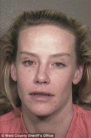 Amanda Peterson was arrested four times between 2000 and 2012. Pictured after arrest in 2000
