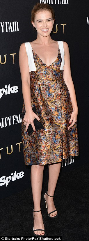 Radiant: Zooey, 20, was a blast of colour for the event, in a multi-coloured silk dress