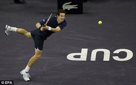 Belter: Andy Murray thumps a backhand winner past Roger Federer in Shanghai yesterday