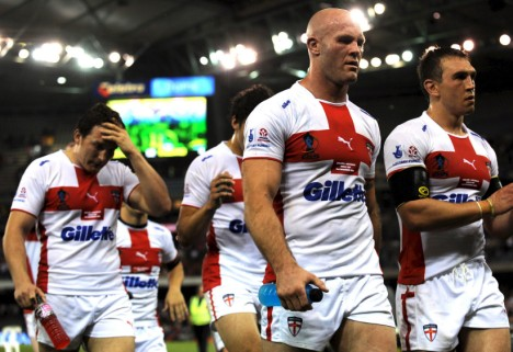 epa01538685 England players (R-L) Kevin Seinfield, Keith Senior express disappointment as they leave the playing filed after losing  the Australia versus England Rugby League World Cup pool match at Docklands Stadium in Melbourne, 02 November 200