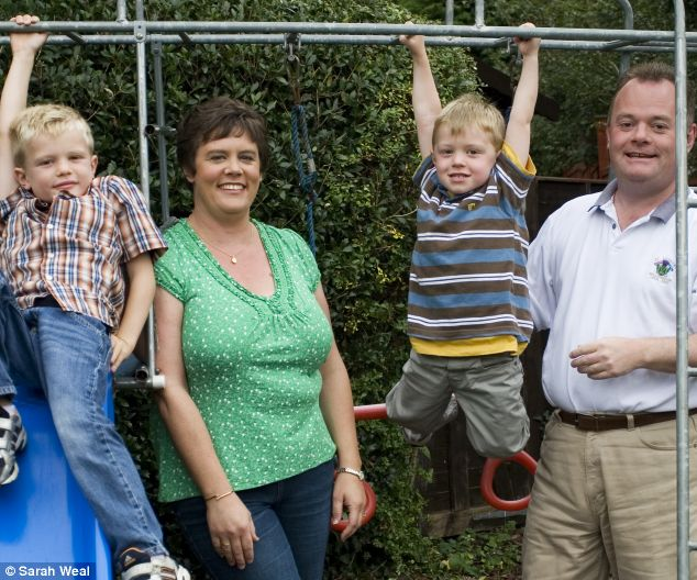 Heather and her husband Campbell with Benjamin, six, and Alastair, four