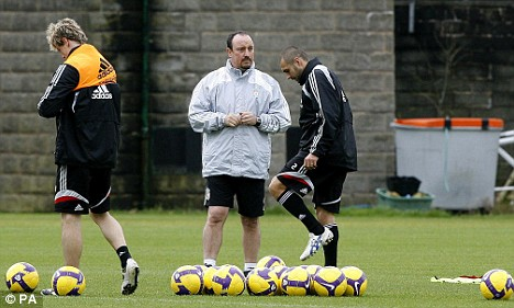Benitez, at Liverpool training with Fernando Torres (left) and Andrea Dossena (right) wants to let his agent sort out his contract