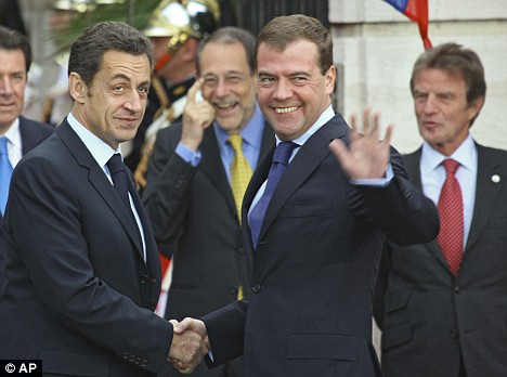 New friends: Sarkozy and Medvedev shake hands today