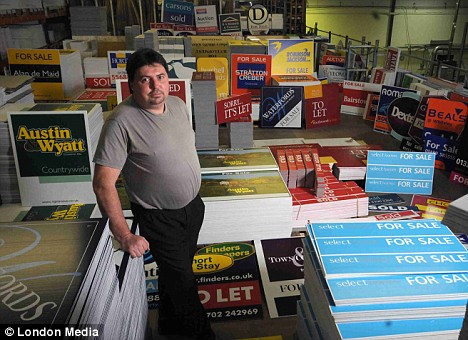 Gary Gosney at the Kremer Signs factory, pictured with the For Sale signs the company cannot sell