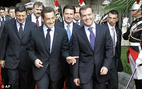 Putin's protege Dmitry Medvedev, right, talks with French president Nicolas Sarkozy, left, this week. Medvedev may step down to force new elections - which, if he ran, Putin would likely win