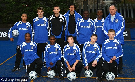 Frank Lampard  and Ballack (back row, centre) at the  launch of the 'Blue Pitches' initiative at  Battersea Park School