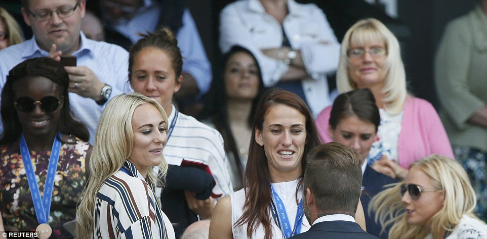 Hero: The England team, wearing their bronze medals from their recent World Cup triumph, beamed with delight as they chatted to former England captain Beckham
