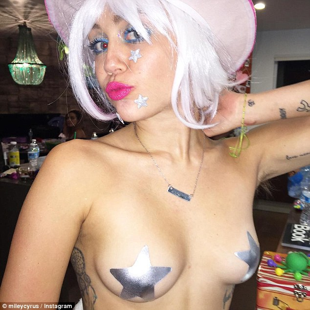 Exhibitionist: Miley Cyrus displayed her pert assets in a topless selfie posted on her Instagram page on Thursday