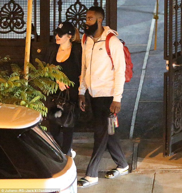 Laid-back: James matched Khloe's casual look in a zip-up Nike sweatshirt, sweatpants, and a pair of slip-on Nike sandals