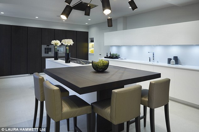 The apartment, ow on sale with a whopping price tag with upmarket property agents, Rokstone and Russell Simpson, has had a very modern facelift since its days as Ms Simpson's love pad