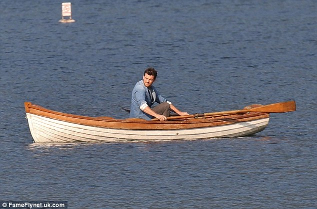 Taking a breather: The star took a few rowing breaks while out on the water