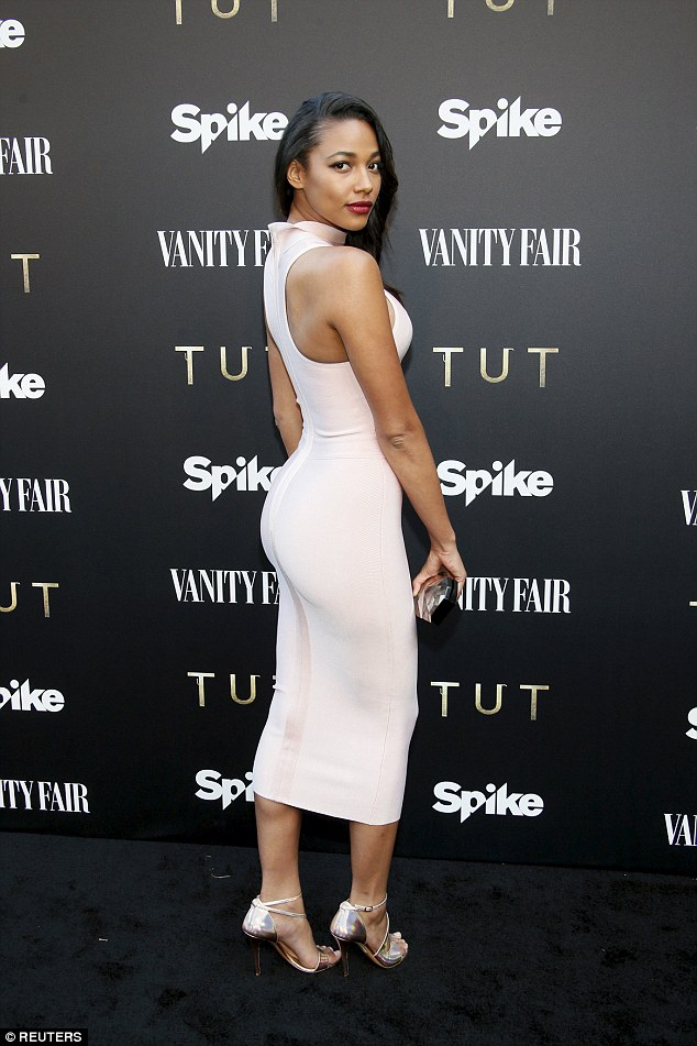 Shapely: Kylie Bunbury, 26, who plays Suhad in the mini-series, emphasised her womanly curves in a figure hugging white tube dress