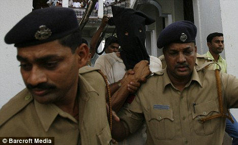 Samson D'Souza being taken to Mapusa court, Goa