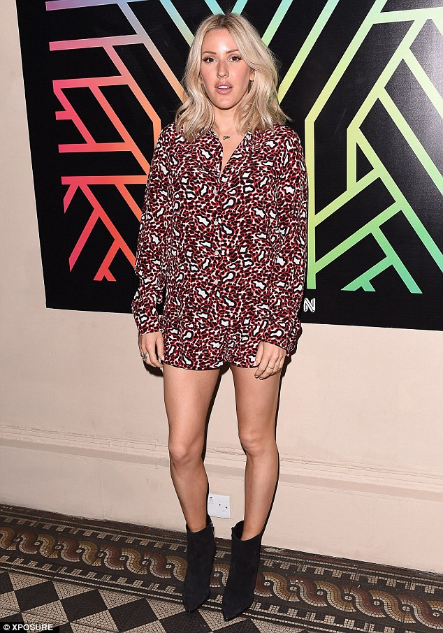 Looking lovely as ever: Starry Eyed hitmaker Ellie turned heads in a striking abstract print playsuit which allowed her to show off her toned limbs, elongated in a pair black ankle boots