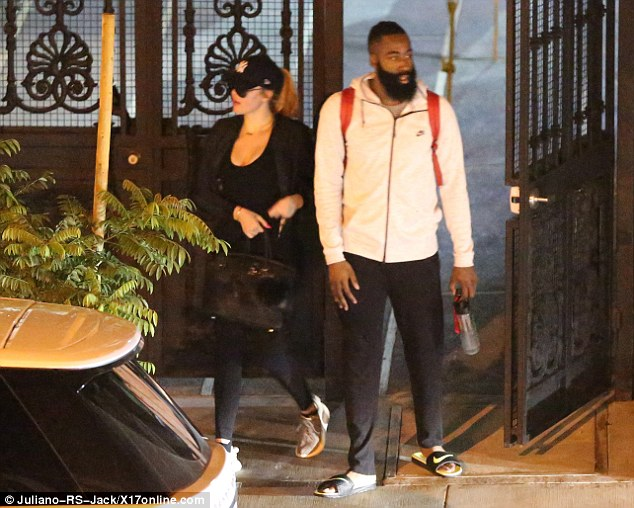 Keeping close: Khloe stayed close to the NBA player as they left the Beverly Hills restaurant