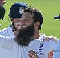 Englandís Moeen Ali, centre,  celebrates after Australia's Michael Clarke, wicket caught and bowled for 38 runs during day two of the first Ashes Test cricket match, in Cardiff, Wales, Thursday, July 9, 2015. (AP Photo/Rui Vieira)