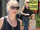 Kimberly Stewart, daughter of rock legend Rod Stewart, was spotted while out walking with her daughter, Delilah, by actor Benicio Del Toro.  Kimberly wore jeans with a black tank top, while Delilah went with a floral top and shorts.  Saturday, July 11, 2015 X17online.com