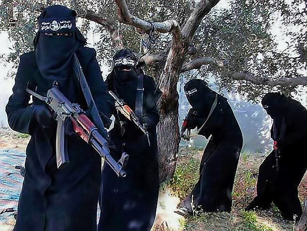 One teacher told of her horrifying capture by the city's ruthless all-women police unit, the Al-Khansa brigade (above), created to enforce IS rules. 'They said my eyes were visible through my veil. I was tortured. They lashed me'
