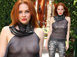 **WARNING NUDITY** Maitland Ward, in a see-through top, gets ready for Comic-Con's Crave Escape party which will take place on the USS Midway Battleship on July 10, 2015 in San Diego, CA.\\n\\nPictured: Maitland Ward\\nRef: SPL1075423  100715  \\nPicture by: Splash News\\n\\nSplash News and Pictures\\nLos Angeles: 310-821-2666\\nNew York: 212-619-2666\\nLondon: 870-934-2666\\nphotodesk@splashnews.com\\n