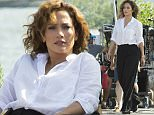 """Jennifer Lopez spotted on the set of """"Shades of Blue"""" in NY. She was relaxing between takes on a hot and steamy day in a parking lot in Long Island City, Queens, NY.  Pictured: Jennifer Lopez Ref: SPL1076174  100715   Picture by: Janet Mayer / Splash News  Splash News and Pictures Los Angeles: 310-821-2666 New York: 212-619-2666 London: 870-934-2666 photodesk@splashnews.com"""