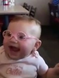 Baby gets glasses and can see for the first time - and loves it