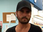 EXCLUSIVE: Scott Disick was spotted posing for a unhappy photo with a Fan, in a Long Island CVS on Friday evening. He was in the store to pick up a Prescription from the Pharmacy. The young fan was eager to take a photo with the troubled reality star, he obliged but did not seem to pleased. He wore a black baseball cap and had a frown across his face , while he waited in line for his order. (Picture taken: 11/07/2015)  Pictured: Scott Disick Ref: SPL1076365  120715   EXCLUSIVE Picture by: Splash News  Splash News and Pictures Los Angeles: 310-821-2666 New York: 212-619-2666 London: 870-934-2666 photodesk@splashnews.com