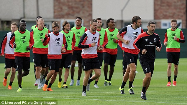 Jordan Henderson (front left) and Rickie Lambert lead the team during a training session at Melwood