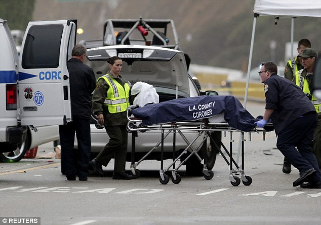 Casualty: A victim, presumably Howe, is loading into a van at the scene after the fatal crash