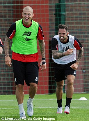 Ings shares a joke with Martin Skrtel