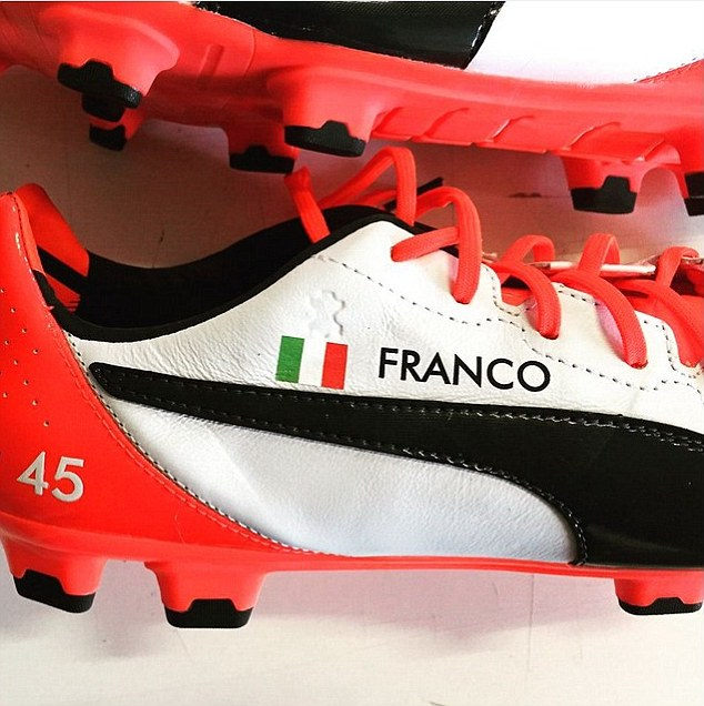 Balotelli posted this photograph on Instagram showing the boots dedicated to his late adoptive father