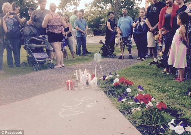 Gathering: Neighbors and friends gather to reflect and pray for Aaden outside his home following his death