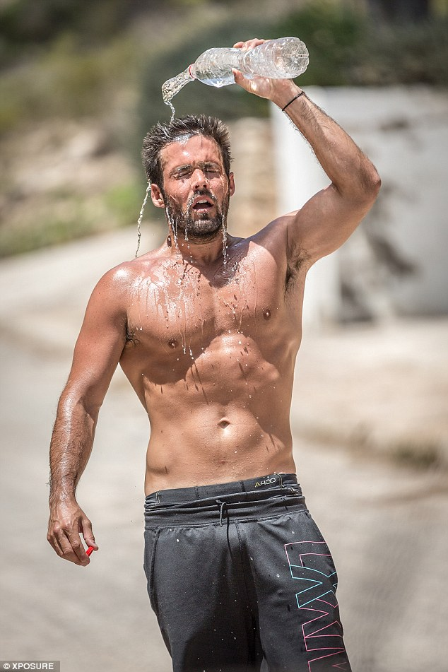 It's getting hot out here: Spencer Matthews cooled off during a hike in Ibiza with his girlfriend Lauren Hutton